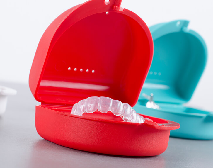 clear aligners sitting in trays